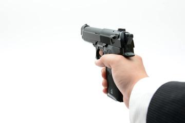 銃を持つビジネスマンの手