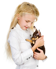 the girl embraces a puppy. isolated on white background