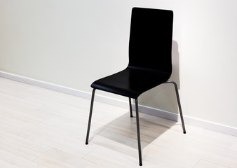 black chair over wall