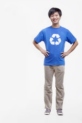 Portrait of young man wearing recycling symbol T-shirt, studio shot