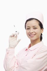 Portrait of Nurse Holding A Syringe, Studio Shot