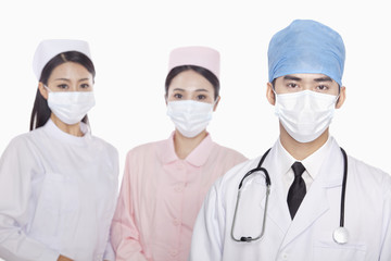 Portrait of Healthcare workers with surgical masks, studio shot