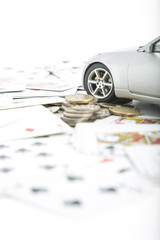 Coins, cards and a car