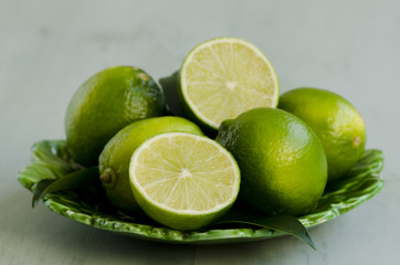 Limes in a ceramic plate.