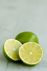Limes in a green wooden background