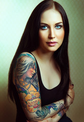 Beautiful glamorous girl with tattoos.