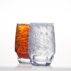 Sparkling cola drinks with water soda and ice in glass isolated