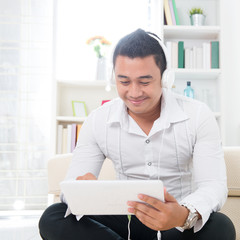 Asian man using tablet pc