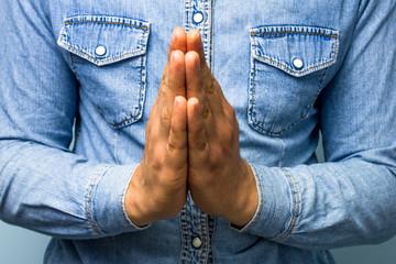 Blue collar worker praying