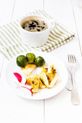 Fresh breakfast with fried eggs, brussels sprouts and radish on