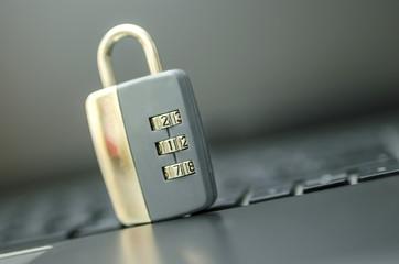 Closeup of padlock on laptop keyboard.