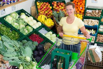 woman buys healthy food