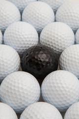 Zelfklevend Fotobehang Golf White and black golf balls in the box