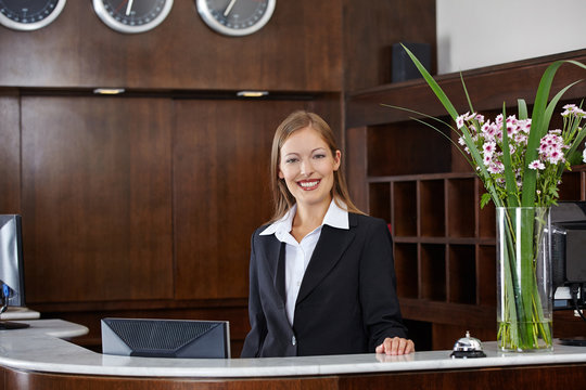 Happy female receptionist at hotel