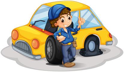 A male mechanic fixing the yellow car