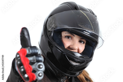Wall mural Happy biker woman with a road helmet and thumb up