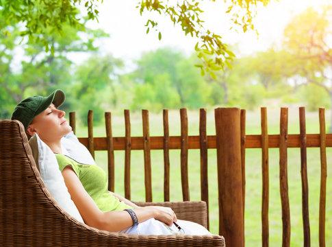 Cute girl resting on veranda