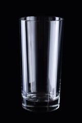 Empty glass on black