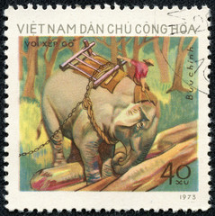 stamp printed in Vietnam shows man on elephant outside