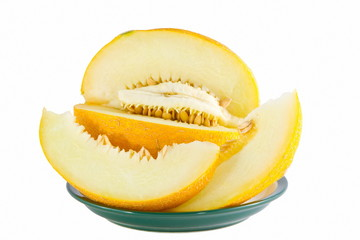 image of yellow ripe melon on a plate