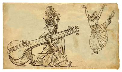 Indian beauty playing the tanpura and the other beauty dancing