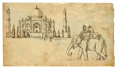 Two people on an elephant outside the palace