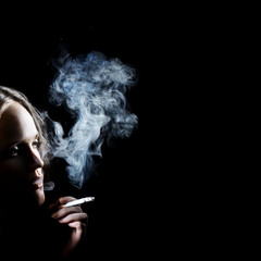 Smoking woman in darkness