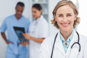Smiling woman doctor looking at the camera