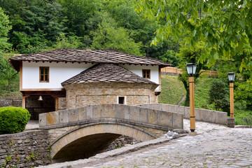 Old house and a stone bridge in the architectural complex Etara,