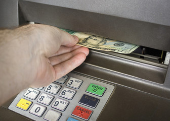 receiving money from the ATM.