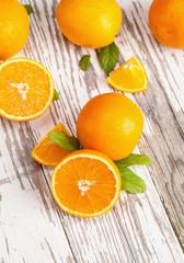 Fresh oranges on wood