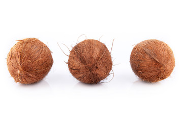 three coconuts isolated on a white