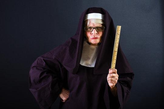 Mean nun with a ruler