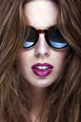 Fashion portrait of young and stylish woman with luxury glasses