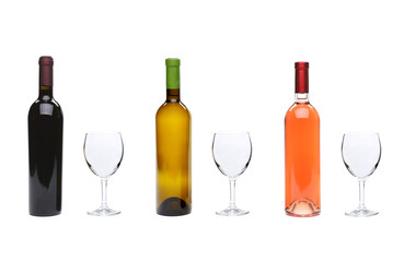 Red, rose, white wine bottles and glasses