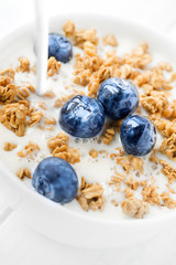 Granola breakfast with blueberries and milk