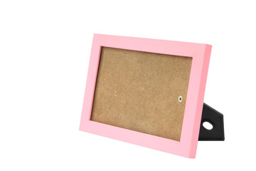 Empty pink picture frame or border with stand isolated on white