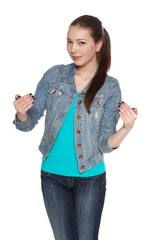 Woman in jeans and denim jacket pointing at herself