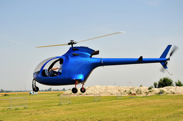 blue helicopter on take off