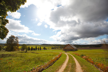 Autumn landscape with a road and house