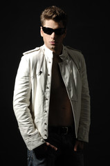 Young handsome man wearing dark sunglasses