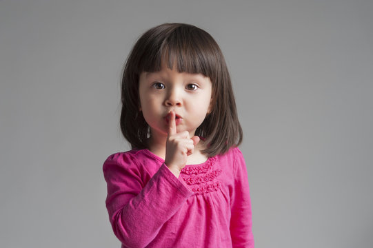 Girl Making A Keep Quiet Gesture