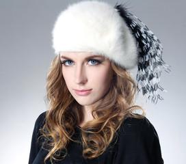 Beautiful fashion model in hat