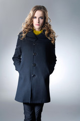 fashion model in coat clothes posing
