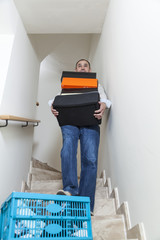 A man is about to trip over the clothing box.Domestic accidents