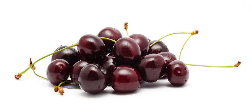 Heap of ripe sweet cherry isolated on a white