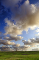 Grassy Hills under Dramatic Sky