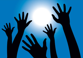Hands reaching into the air against the sun