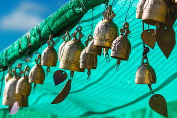 Wall Murals Green coral tradition asian bell in Big Buddha temple complex, Thailand