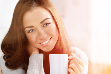 Attractive woman drinking coffee at home